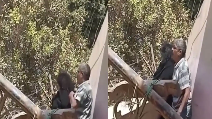 رجل يحاول إلقاء زوجته من البلكونة